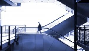 business man moving on escalator